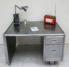 office metal desk. vintage industrial stripped and polished steel metal desk office