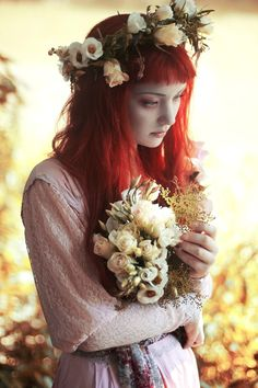 This photo symbolizes Ophelia adorned with flowers and singing strange songs, showing that she seems to have gone mad.