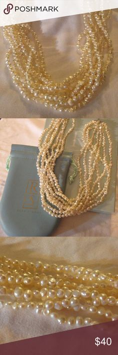 Ross Simons freshwater pearl torsade This fabulous freshwater pearl torsade necklace gleams and glows! 8 strands of 5-6mm cultured freshwater pearls. 14 inches of pearls with a 4 inch extender. Torsade necklace features a sterling silver clasp.  Comes with original pouch and box. Ross Simons Jewelry Necklaces