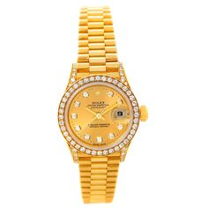 Rolex President Ladies 18k Yellow Gold Diamond Watch 69158 - Rolex President Ladies 18k Yellow Gold Diamond Watch 69158. Officially certified chronometer self-winding movement . 18k yellow gold oyster case 26.0 mm in diameter. Diamond lugs. Rolex logo on a crown. 18k yellow gold diamond bezel. Scratch resistant sapphire crystal with cyclops magnifier. Champagne diamond dial with original Rolex factory diamond hour markers. Date calendar at 3 o'clock aperture. 18k yellow gold president ...