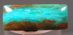 9.5cts GEM BLUE OPAL PERU CABOCHON PENDANT JEWELRY COLLECTORS REIKI MINERAL Size: 2.4 x 1 cms http://www.therockingstonesperu.com/