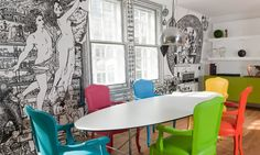 The refurb of a central London flat: pop-art design meets mural art. Boldly painted chairs in contrasting colours. Each member of this family has its own colour. | The artefacts, which belong to the owner's collection are painted on the walls and on the window panes. The real collection is housed in his holiday home. | @lammhults @kartelldesign floslighting #designbest