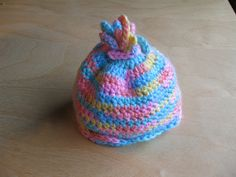 This is a basic, top-down baby hat, sized to fit a preemie and perfect for charity crocheting.