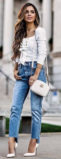 white and denim outfit lace up top bag heels jeans