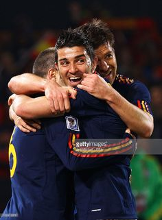 Andres Iniesta (L) of Spain celebrates scoring with David Villa (C) and a950cdf037849
