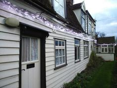 Essex timber weatherboard country cottage with lights