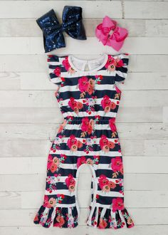 9163f11fb99 Flutter sleeve navy stripe and pink floral jumpsuit with ruffled legs. Any  accessories shown are