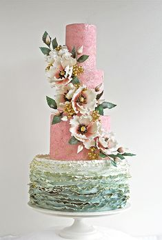 www.cakecoachonline.com - sharing...Brides.com: . Rick Reichart of cakelava fashioned this stunning sage green and pink wedding cake that features textured fondant-covered tiers, gold-tinged ruffles, and a cascade of handmade sugar blossoms