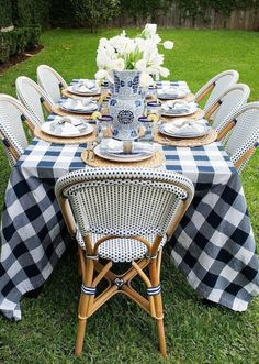 French bistro chairs + buffalo check tablecloth make for a beautiful blue and white setting for dining al fresco! See how at houseofharper.com #dining #summer #tablesettings #spring #outdoor