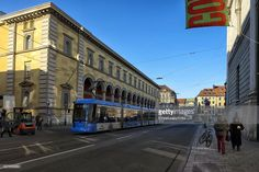 The blue tram passing in front of the National theater building in Maximilian Street in Munich.The city has excellent public transport reaching almost anywhere with a punctual timetable.