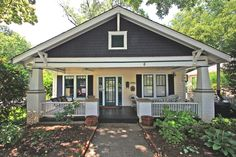 Holly, this looks like your house in differ colors.This classic Thomas Avenue bungalow is located just a hop, skip and jump away from all that's buzzing in Charlotte's Midwood neighborhood!