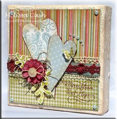 This is a 6 x 6 canvas that I created using the Mojo Monday 206 sketch layout.    Details can be found here: http://inkclinations.blogspot.com/2011/09/mojo-monday-206-canvas.html
