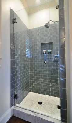 'Ice' Glass subway tile in shower. I like the dark hue. Would like to maybe take it across to cover the entire wall where the sinks are. Floor to ceiling, one wall + shower/bath tile.