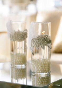 pearls on bottom, floating candle on top. glitter decor at water line...this is pretty!