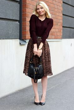 Love this rich burgundy sweater with leopard skirt.  I'd wear more comfortable shoes with this, of course.