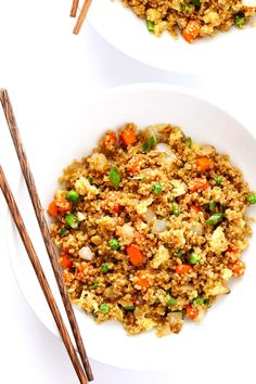 """This 15-Minute Quinoa Fried """"Rice"""" recipe is the best!! It's super easy to make, full of big flavors, and it's the perfect side or main dish. Feel free to add chicken, pork, tofu, shrimp, beef, or veggies if you'd like! 