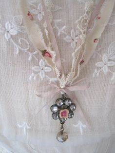 vintage cotton fabric + silk ribbon + vintage earring = romantic necklace...The Robin and Sparrow