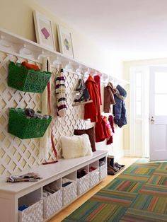 "Organization Maximize wall space in an entryway with cut-to-fit lattice from your local home-improvement store or garden center. Thread S-hooks through the slats to hang baskets filled with scarves, hats and Rover's leash. Lattice, $18; Lowe's stores. Green ""Carrie"" baskets, $39 each; unicahome.com."