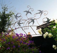 This is a beautiful piece. The movement conveyed.  Bird trellis by Shawn Lovell Metalworks.