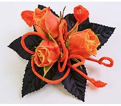 Prom corsage with orange sweetheart roses, black leaves and flexwrap covered wire