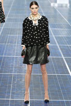 Chanel. Black skirt suit and pearls.  Editors' Pick, New York Spring R.T.W. 2013.