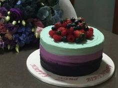 Colourful buttercream swirl cake with berries on top. www.facebook.com/cakesbyleannerhodes