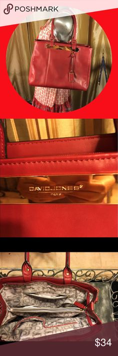 David Jones Paris Large red purse Beautiful in red David Jones Paris Purse.  Man made material beautiful lining.  3 compartments in purse with additional pockets. Zippers shut. Great color for any season. Used but in new condition. The only mark I could find are 2 teenie scratches on the front plaque. You have to look super close. 😃 David Jones Paris Bags Shoulder Bags