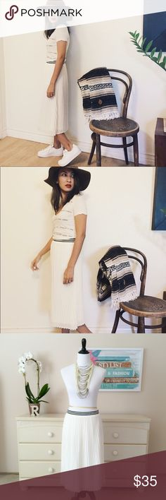 💜 Pleated Midi Skirt with Silk White is in season all year long. In white, this pleated midi skirt with silk has an elastic band at the waist for an easy slip on. Elastic band features a black and white stripe for the subtle print design. Tuck in your top for the stripe print to pop out, or untuck for a casual look, this is a midi skirt you can style over and over again.  Measurements laying flat: Waist-to-hem length: 26″ Width at waist, laying flat: S – 13″ | M – 14″ | L – 15″ Color: white…