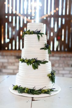 white wedding cake topped with flowers