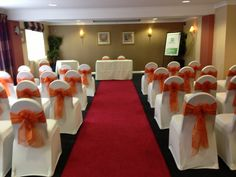 Ivory lycra chair covers with burnt orange sashes x