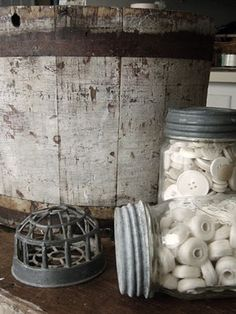worn white bucket mason jars with zinc lids....frog