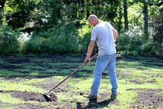 man raking black compost over lawn using aluminum landscape rake Lawn Care Schedule, Lawn Care Tips, Landscape Rake, Lawn And Landscape, Reseeding Lawn, Fall Lawn Care, Lawn Soil, Lawn Repair, Lawn Edging