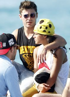 Young love: Zac and his rumoured new girlfriend Michelle Rodriguez were spotted leaving Justin Bieber's yacht in Formentera, Spain on August 8