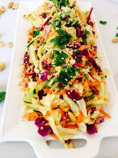 Seasonal Thai Slaw - - A bright and colorful rendition of slaw filled with all that beautiful Thai flavor you love. Loaded with peanuts, sesame seeds, sesame oil, soy sauce, rice vinegar, garlic, parsley and cilantro.