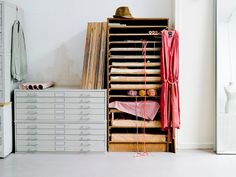 Would love a studio space like this with sealed paper drawers and open wood shelves. It reminds me of art school. Sigh...
