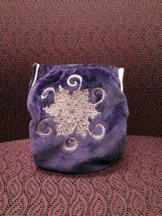 Snowflake Embroidered Minky Cloth Diaper from RosyBunz on Etsy.com.  $39 but well worth it.  This is beautiful.