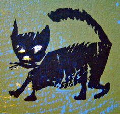 "Woodcut by Antonio Frasconi, cat from ""See and Say""."