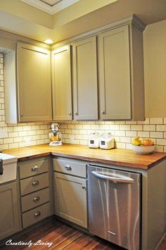 white beadboard cabinets, butcher block counter, yellow walls - Google Search