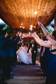 Fourth of July Wedding in Columbus, OH / Photography: Robb McCormick / Sparkler send off/ Classic Wedding With A Tropical Twist Featured On Midwest Bride http://www.theeventprep.com / July 4th Wedding/ Fourth of July Bride and Grooms
