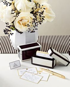 Set out lacquer containers holding these cards stamped with lucky talismans, like horseshoes and wishbones, and have guests jot down their sentiments