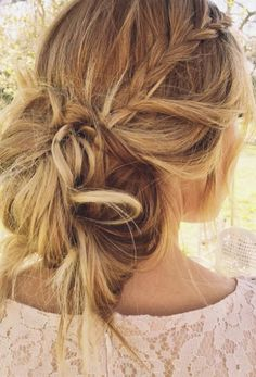 "There's much to love about this style: the undone texture, the messy bun, and the barely-there braids. ""The braids of today are all about embracing your natural texture, allowing it to have a few flyaways and frizz to give it that cool factor,"" says Sims. """