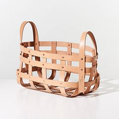 Leather Strap Baskets | Unison| Designed by Alissia Melka-Teichroew and Mimot Studio, these baskets are leather with copper plated rivets and yellow contrast stitching.