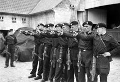 @jjrumena of the 4th Royal Tank Regiment practising with their .38 revolvers in a farmyard near Arras, October 1939.