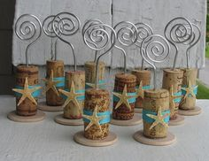 Starfish Wine Cork Place Card Holders. Made with aluminum floral wire and wooden disk on bottom.