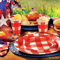 Give your summer grilling party a festive red, white and blue theme with a cute tablescape.