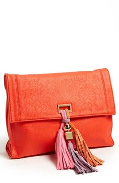 A trio of tassels adds dynamic swing to an oversized, faux-leather clutch, with an optional chain strap for crossbody carry.  Magnetic -flap closure. Optional chain-link strap. Exterior zip pocket. Interior zip pocket. Polyurethane. By Deux Lux