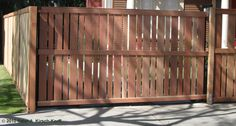 Thick-thin alternating wood fence. Maybe just the bottom half for the front?   Custom Craftsman Steel Frame Driveway Gate with Matching Fence - West Hollywood, CA