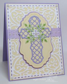 handmade Easter card: Lavender Cross by angelladcrockett  ... all die cuts ... lacy cross and background pattern layered tag with pierced borders ... soft yellow, lavender and white ... gorgeous card!!