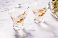 Looking for a new martini recipe? Explore fun and flavorful cocktails inspired by the classic Gin Martini including classic recipes and modern favorites. Dry Gin Martini, Gin Martini Recipe, Best Martini Recipes, Cocktail Recipes, Martinis, Cocktail List, Cocktail Ideas, Drink Recipes, Classic Gin Cocktails