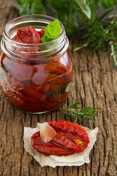 Homemade sun dried tomatoes with thyme, rosemary and basil.